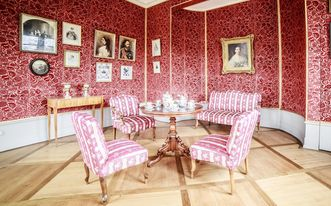 Upholstered furniture in the garden room at Kirchheim Palace